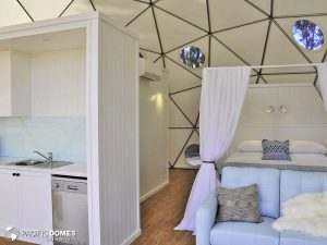 mile-end-glamping-interior-bed & kitchen