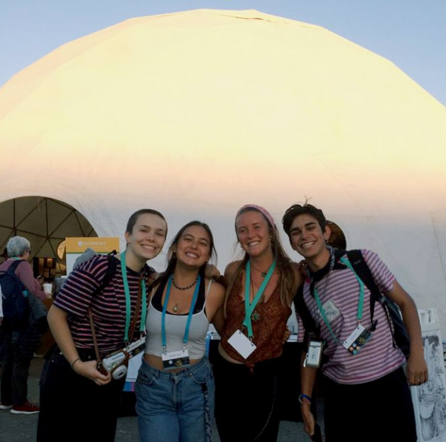 Bioneers pose in front of the re:DOME at Bioneers Conference 2018