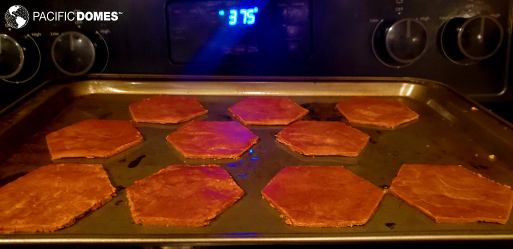 Gingerbread hexagons cut from dough and ready for the oven!